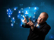 Businessman choosing from social network map Stock Photo
