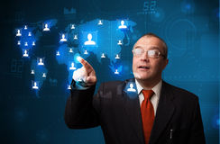 Businessman choosing from social network map Stock Image
