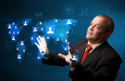Businessman choosing from social network map. Businessman standing and choosing from social network map Stock Photography