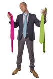 Businessman choosing tie isolated on white background royalty free stock photo