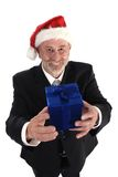 Businessman Christmas. Senior Businessman with Christmas gift and Santa Claus hat Stock Images