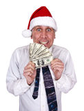 Businessman Christmas Bonus Santa Claus Hat Money. Funny look with a sloppy businessman getting money for a Christmas bonus. Cash is always welcome at Xmas! This stock photos