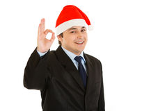 Businessman in Christmas hat showing ok gesture Stock Photography