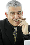 Businessman with cigar Royalty Free Stock Images