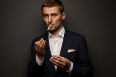 Businessman with cigarette stock photography