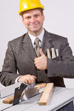 Businessman and circular saw Stock Photos