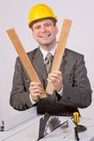 Businessman and circular saw Stock Photography