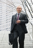 Businessman in the city. Senior businessman in front of the office building Stock Photos