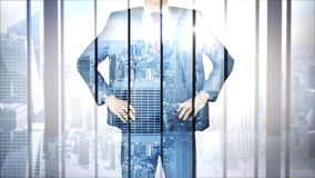 Businessman with city and skyscraper overlay stock video
