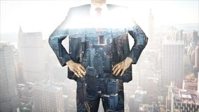 Businessman with city and skyscraper overlay stock footage