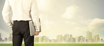 Businessman with city view Royalty Free Stock Images