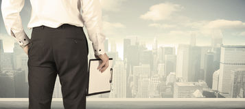Businessman with city view Stock Images