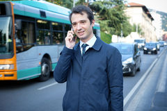 Businessman in the city  talking on mobile phone Stock Photo