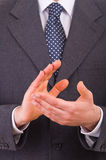 Businessman clapping his hands. Stock Photo