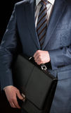 Businessman clasping briefcase Stock Photos