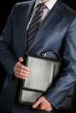 Businessman clasping briefcase Royalty Free Stock Image