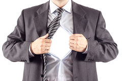Businessman in classic superman pose stock images
