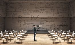 Businessman in clean classroom royalty free stock image