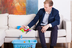 Businessman cleaning child's toys Royalty Free Stock Photography