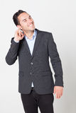 Businessman cleaning his ear Stock Photo