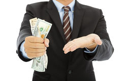 Businessman clench us dollars and gesture. In studio royalty free stock photo