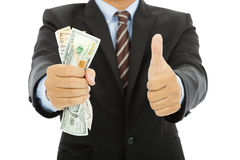Businessman clench us dollars and thumb up. With white background royalty free stock images