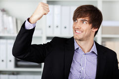 Businessman With Clenched Fist Celebrating Victory In Office Stock Photography