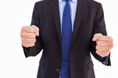 Businessman with clenched fist in front of him Royalty Free Stock Images