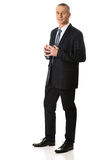 Businessman with clenched hands Stock Photo
