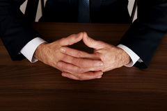 Businessman clenched hands on the desk Royalty Free Stock Image