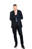 Businessman with clenched hands Stock Image