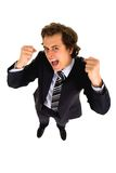 Businessman clenching fists. Young businessman clenching fists and shouting Stock Images