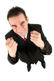 Businessman clenching fists. Portrait of a young businessman clenching his fists and laughing Royalty Free Stock Images