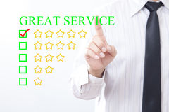 Businessman click concept GREAT SERVICE message, Five golden st. Ars royalty free stock image