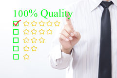 Businessman click concept 100% Quality message, Five golden star. S Stock Photography