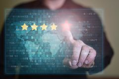 Businessman click on five red stars to increase rating. Review, increase rating or ranking, evaluation and classification concept stock image