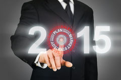 Businessman clicking on 2015 business target Stock Images