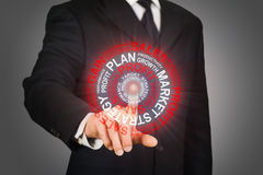 Businessman clicking on a business target Royalty Free Stock Photos