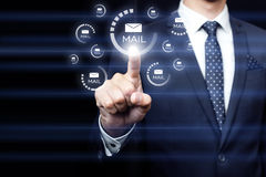 Businessman clicking on email icon Royalty Free Stock Photos