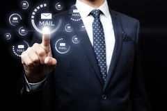 Businessman clicking on email icon Stock Images