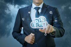 Businessman clicks on big data cloud . Businessman clicks on big data cloud on blue background stock images
