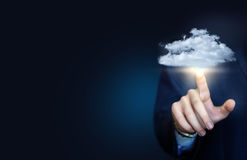 Businessman clicks on a data cloud. Royalty Free Stock Photo