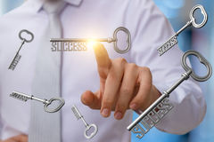 Businessman clicks on the key to success . Businessman clicks on the key to success on blurred background Royalty Free Stock Images