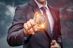 Businessman clicks on the search button. royalty free stock images