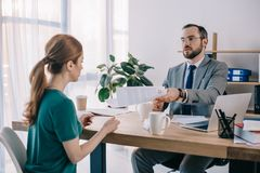 Businessman and client discussing contract during meeting. In office royalty free stock images