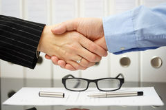 Businessman and client are handshaking over very good agreement Stock Image