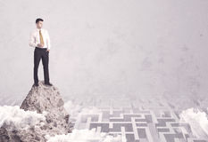 Businessman on cliff above labyrinth Royalty Free Stock Photos