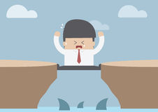 Businessman between the cliff with shark, Business crisis concep Royalty Free Stock Image