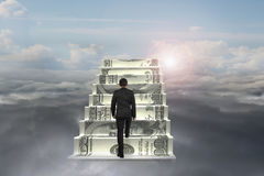 Businessman climb on money stairs with natural sunlight cloudsca Royalty Free Stock Photos
