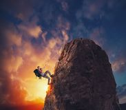 Businessman climb a mountain to get the flag. Achievement business goal and difficult career concept. Businessman climb a mountain with a rope to get the flag royalty free stock image
